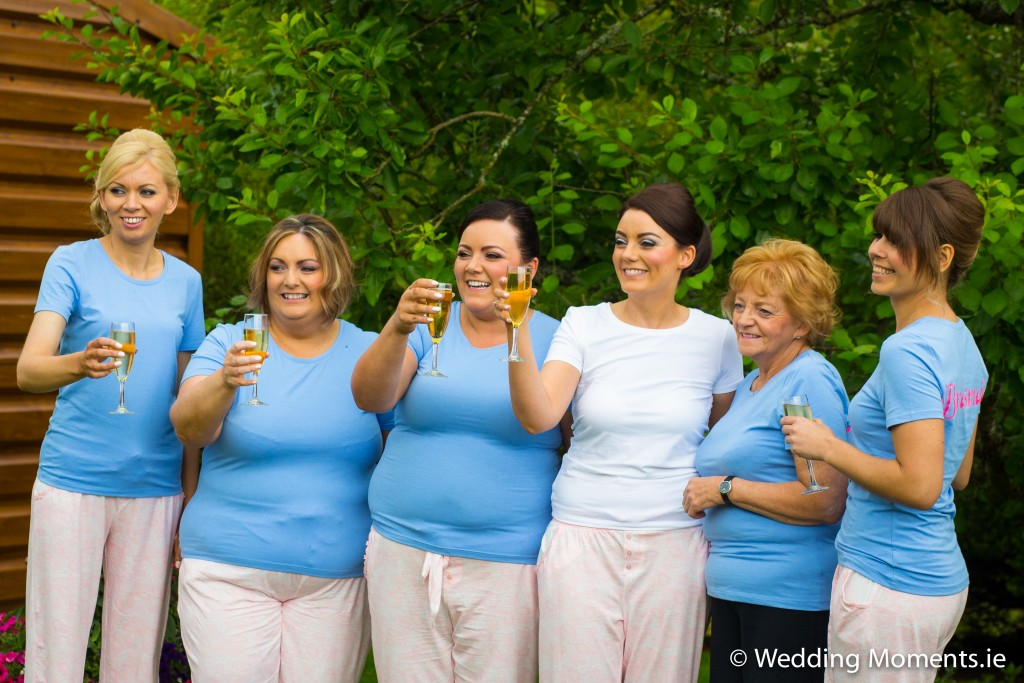 bridemaids toasting and celebrating in garden