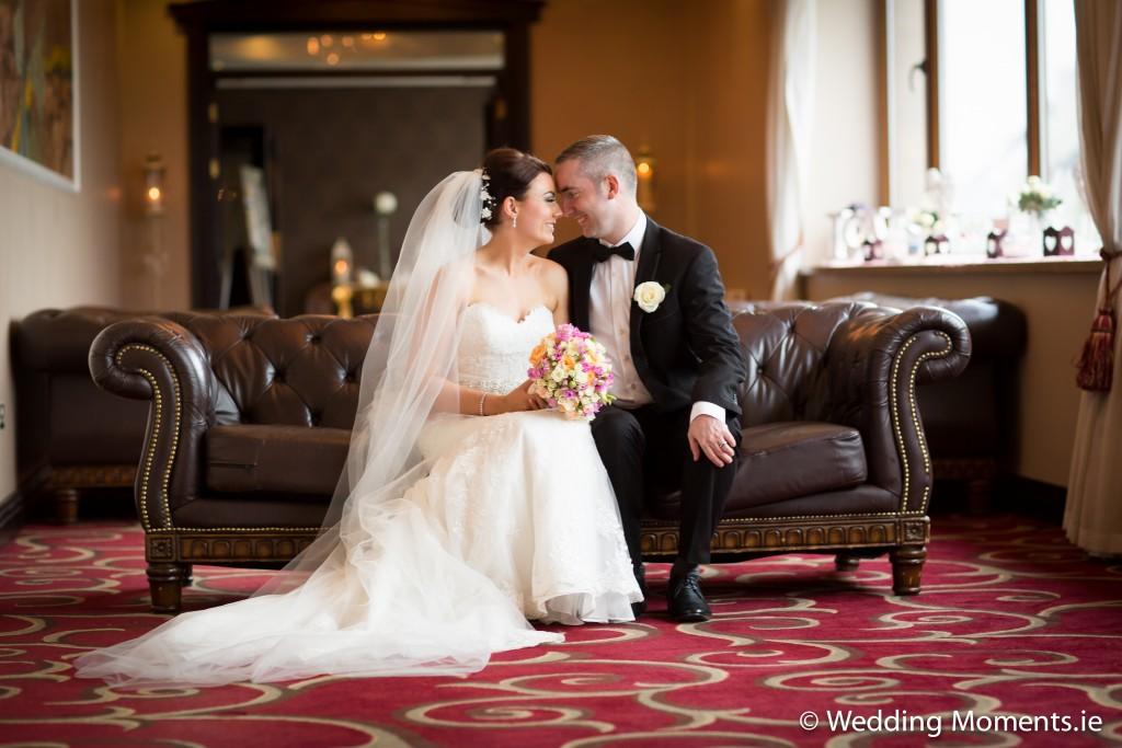 bride and groom sitting on a coach in the diamond coast in Sligo