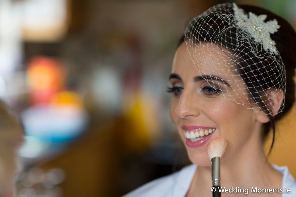 bride smileing getting her blusher done