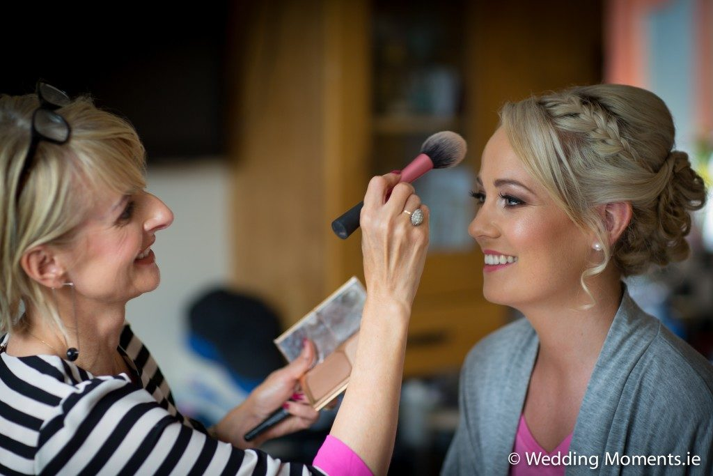 bridesmaids getting her makeup applied