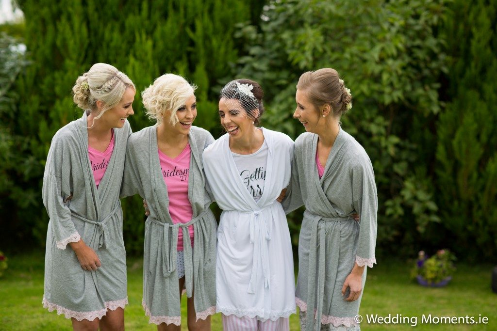 bridemaids and bride laughing