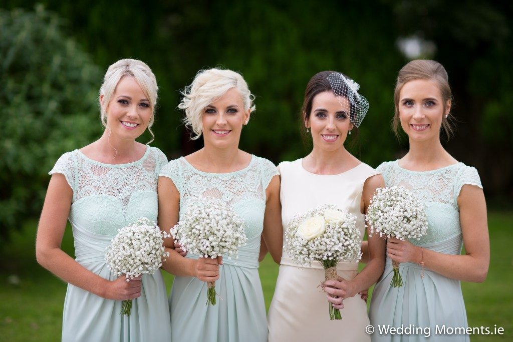 group photo of bride with a beautiful background blur