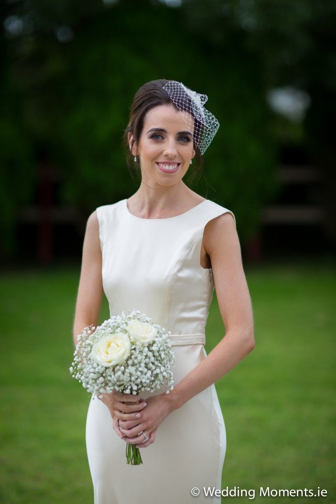 bride standing holding flowers
