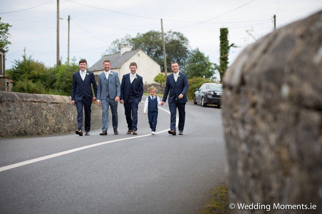 groomsmen arriving at church