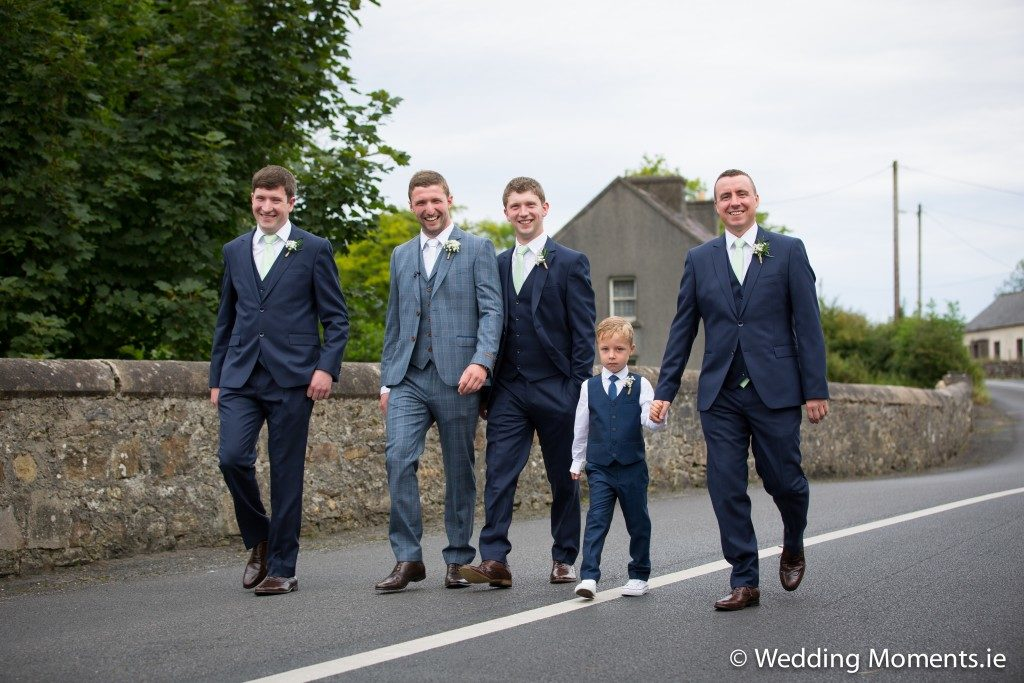 closeup up groomsmen arriving at church