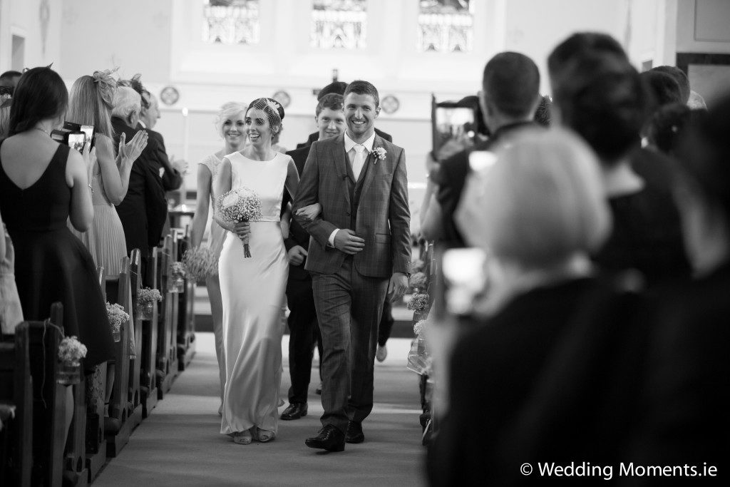 bride leaving church with her new husband
