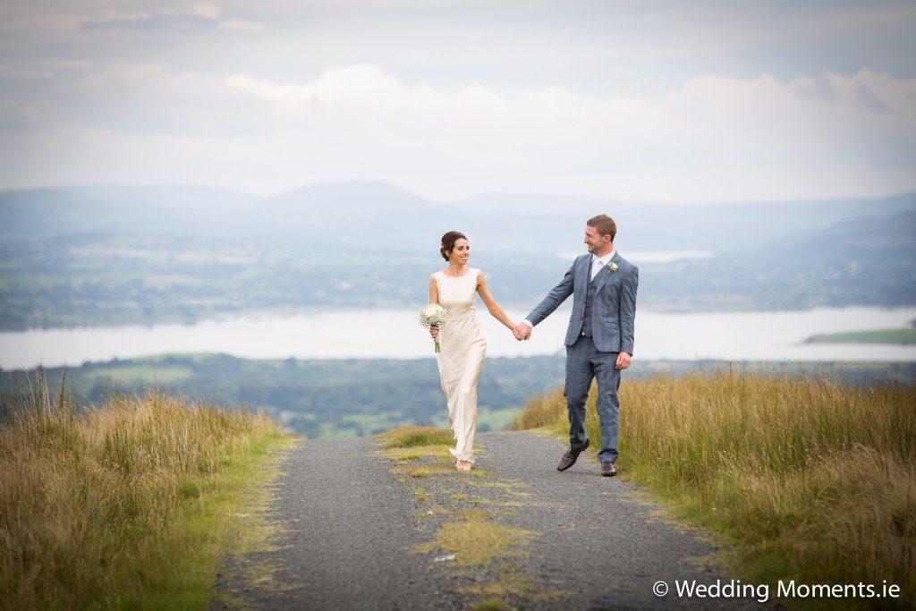 bride and groom walking on top of ladies brae in sligo