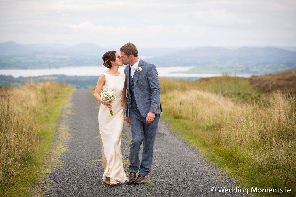bride and groom kissing at ladies brae in sligo