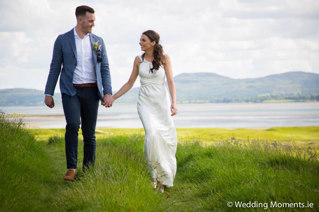 Wedding of bride and groom walking