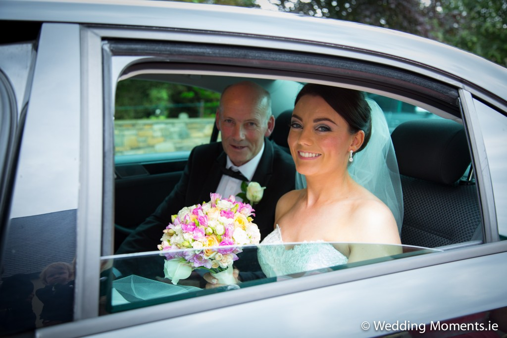 bride in car with her dad