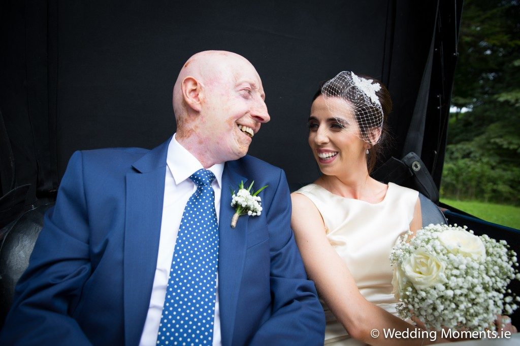 bride with her dad in wedding car