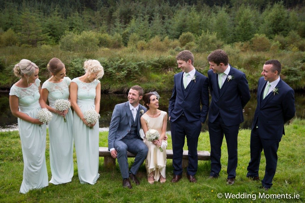 bridal party and bride and groom having a laugh