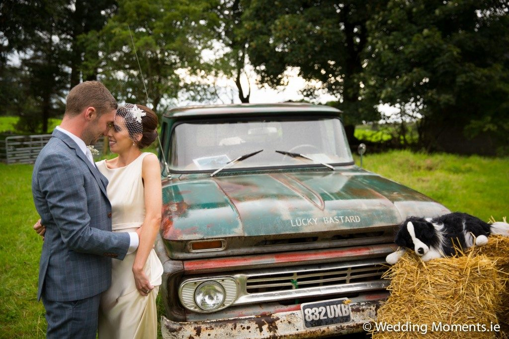 beautiful wedding pose in front of old vintage truck