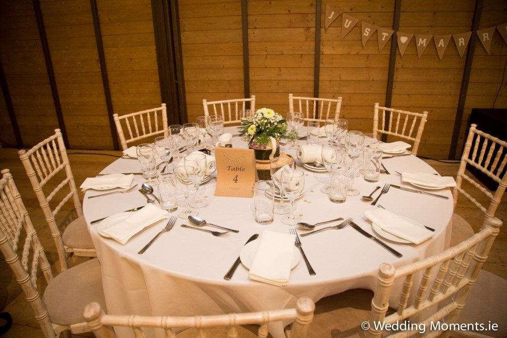 wedding wicker chairs and table setting